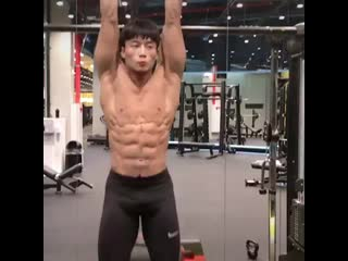 Muscle korean boy in the gym