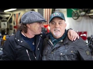 Billy Joel & Brian Johnson take a tour of Billy's motorcycle shop in Oyster Bay, NY