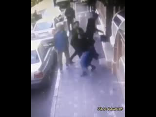 Muslim man attacks woman walking down a street in Iran as some of her hair was showing