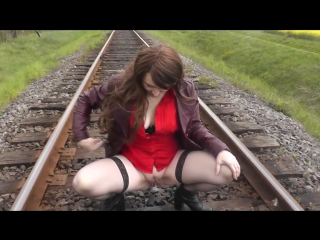 Naked in public. mature woman without panties poses near train. piss public | dubarry