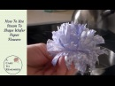 Wafer paper flowers and steam to manipulate them for cake decorating