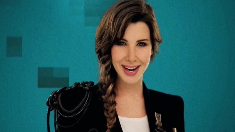 Nancy Ajram Feat K'naan Waving Flag Official Music Video نانسي عجرم شجع بعلمك فيديو كلي 1