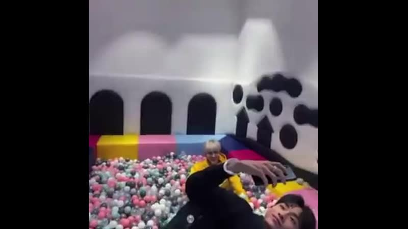Xiaojun having a good time playing in the ball pit with winwin casually taking a selfie on