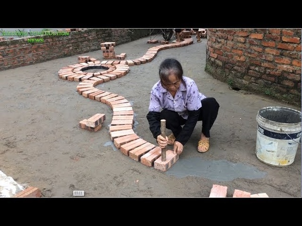 Innovative Construction Uses Bricks And Mortar To Create A Spiral Line Building Smart Bricks