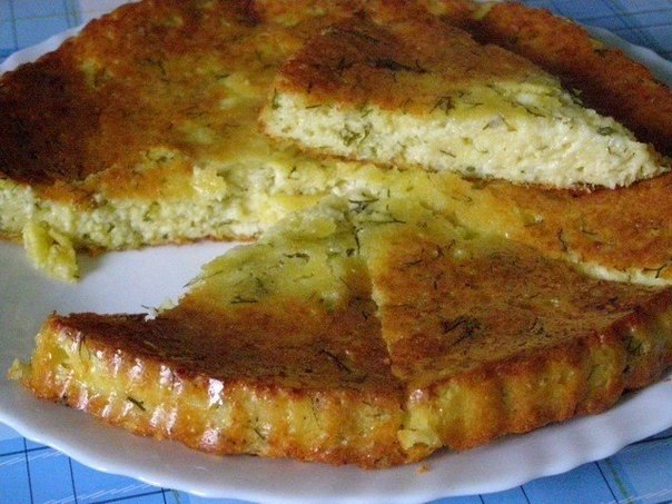 Вкуснейший сырный пирог Ингредиенты:Сыр твердый - 200 гТворог - 300 гКрупа манная - 3 ст.л.Яйцо - 3 шт.Чеснок - 1-2 зубчика (по желанию)Укроп - маленький пучокКефир - 100 млСоль, перец - по